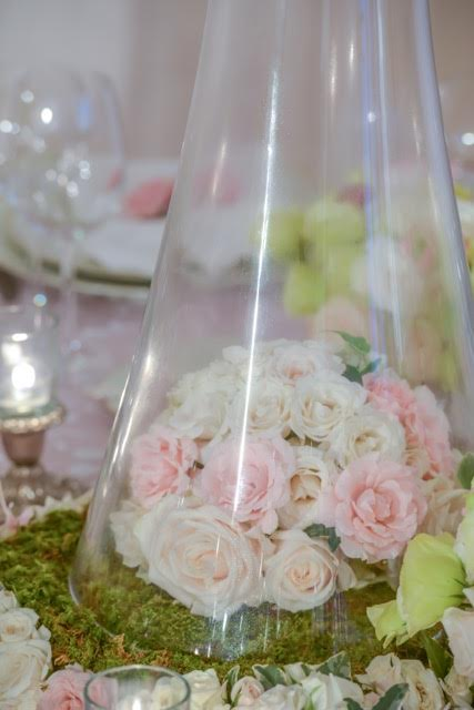 The bell shape  standing base of the vase can also be used to create another floral moment.