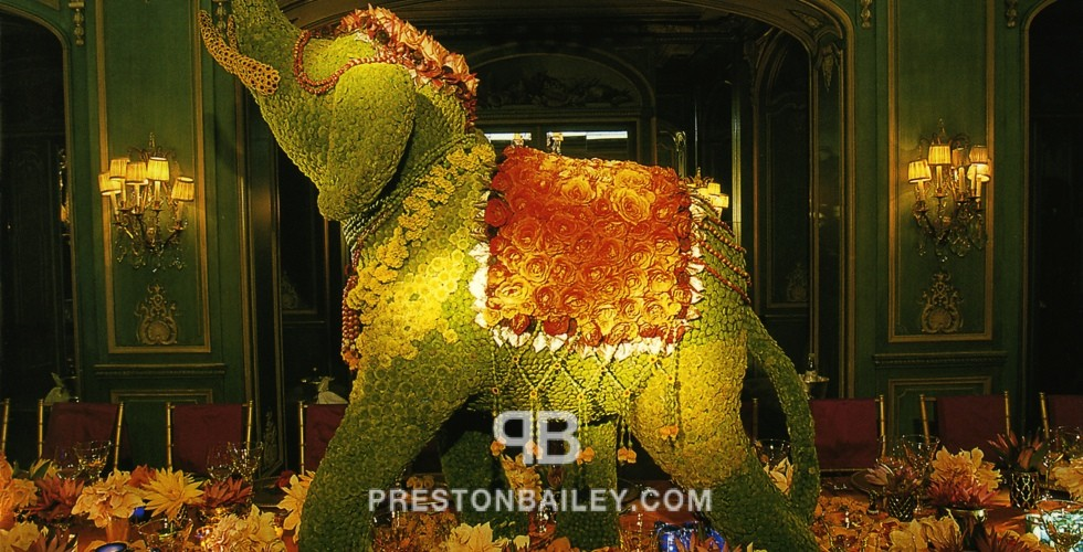 centerpiece floral screen floral sculpture flowers long table moss orchid reception roses sunflowers tall centerpiece color|brown color|green color|orange color|red elephant