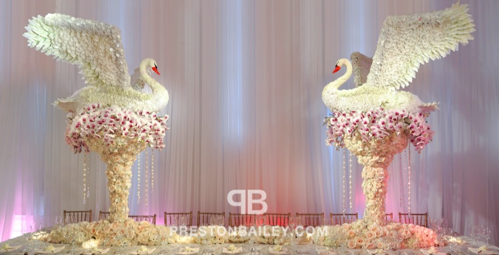 centerpiece floral sculpture flowers orchid reception roses table setting tall centerpiece wedding color|cream color|pink color|white