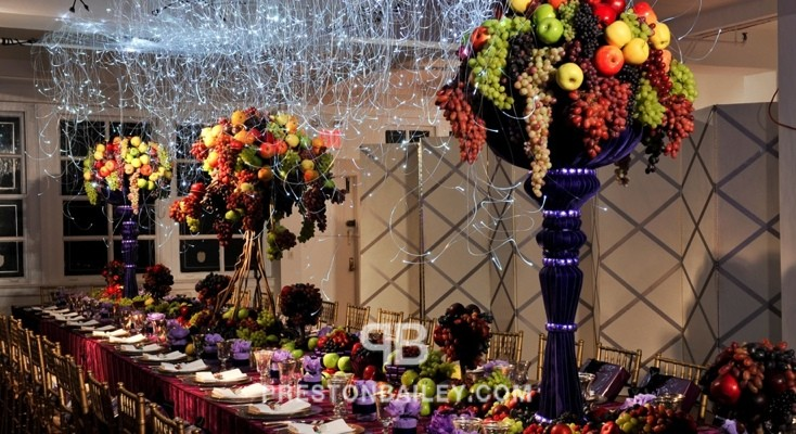 centerpiece chandelier dining entertaining fruit hanging lights holiday inspirations long table table setting tall centerpiece thanksgiving color|brown color|green color|orange color|pink color|purple color|red color|yellow