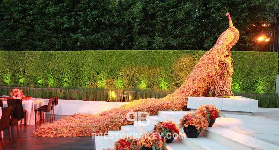 branches leaves orchid outdoor reception summer wedding color|brown color|orange