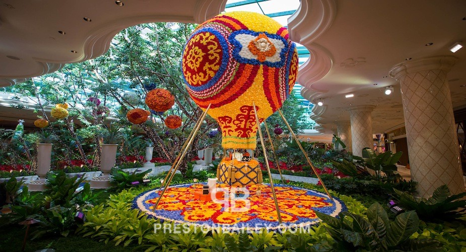 art installation branches floral floral sculpture flowers indoor leaves plants color|beige color|blue color|gold color|green color|orange color|red color|turquoise color|yellow