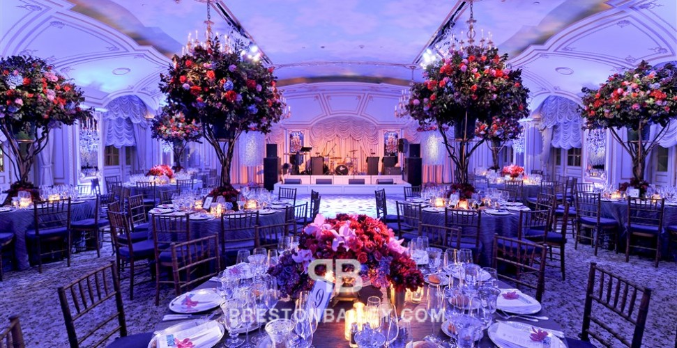 ballroom birthday party candles centerpiece dining entertaining hydrangeas roses round tables stage table setting tall centerpiece color|blue color|lilac color|pink color|red color|violet